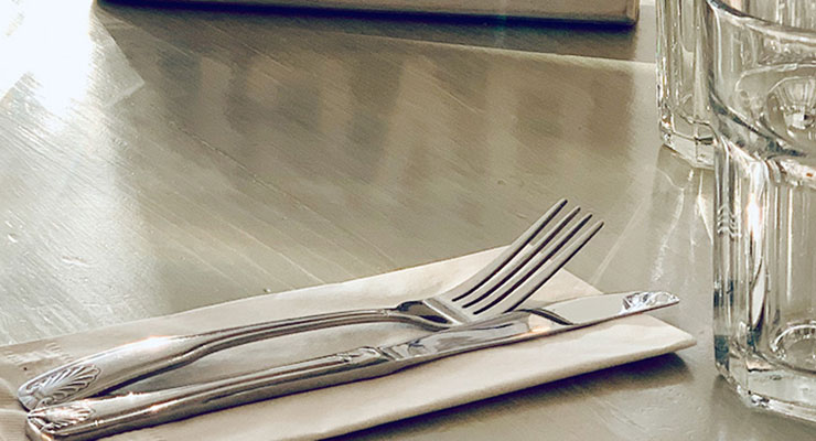 One Diet Doesn't Fit All: Navigating the confusion and discovering the diet that's best for you, by Ocean Robbins. Photograph of a table set for dinner by Kristen Noel