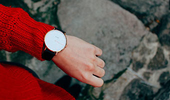 20 Things You Can Do For Yourself If You Only Have 20 Minutes by Rachelle McKeown. Photograph of woman looking at her watch by Ana Azevedo