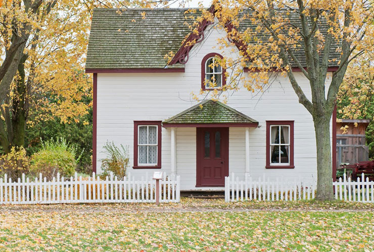 I Can't Believe You Didn't Leave Me: How a Working Mom Learned to Show Up by Colleen Hauk. Photograph of house in autumn, under a maple tree by Scott Webb