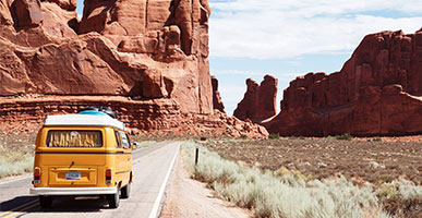 Road Trips With Babies and Toddlers: 5 Tips To Survive and Thrive by Scott Pine. Photograph of a camper van driving through Utah by Dino Reichmuth.
