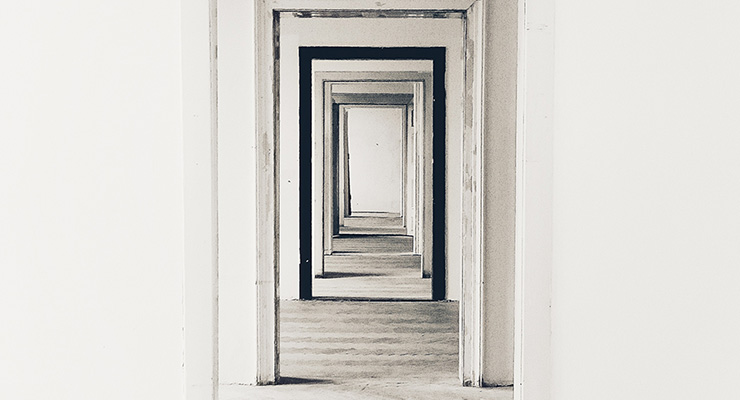 Radical Responsibility: The Key To Moving From Suffering To True Self-Agency & Freedom by Fleet Maull. Photograph of several open doors going down a hallway by Filip Kominik