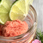 Recipe: Watermelon, Coconut & Lime Granita by Chef Christine Moss. Photograph of a mason jar with watermelon, coconut & lime Granita.