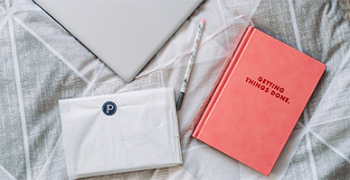 """7 Productivity Tips that Can Change Your Life, at Work and at Home by James Dorian. Photograph of a laptop and a journal that says """"getting things done"""" on the cover by Anete Lusina"""