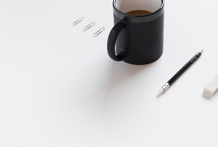 Stop Over-Thinking: 8 Steps To Clear Your Mind by Arslan Hassan. Photograph of a clear paper with a pencil, eraser and paperclips lined up by Bench Accounting