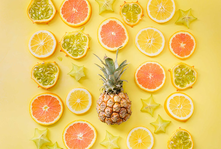 What Happens When You Don't Eat Enough Fruits and Vegetables? by Sofia Alves. Photograph of a pineapple and other suit slices by Brooke Lark