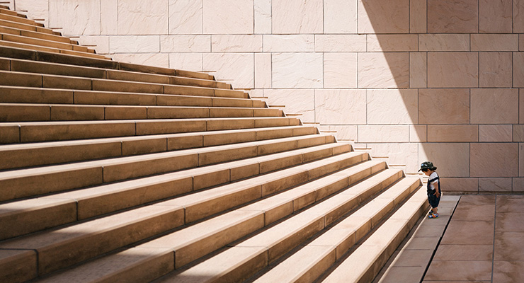 Being True to You: Honoring Your Calling, One Step at a Time by Monica Levi. Photograph of a toddler at the bottom of a long staircase by Jukan Tateisi